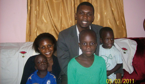0512 - Umar and Evelyn with children