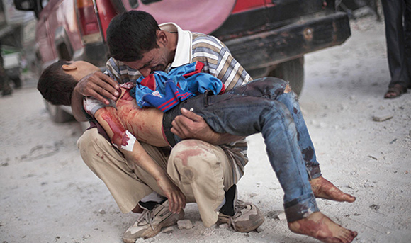 1013 - Syrian man weeps loss of son