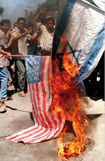 1112 - Muslims burn American and Israeli flags