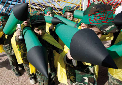 0209-Hamas children carry rockets