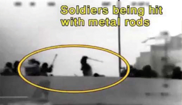 0710-Soldiers hit with rods