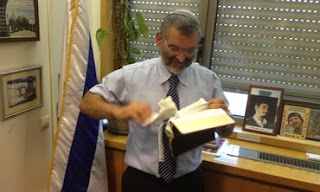 Knesset Member tearing New Testament